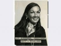 "Typed text attached to front of image: ""Liz Ackerman, President; 1977 - $130,000"""
