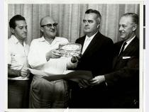 A black and white photo of Al Freeman, unspecified, and three others at the Sands Hotel in Las Vegas, Nevada. The man second fr