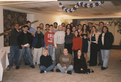 Photograph of Hillel students at Chanukah auction, circa 1995