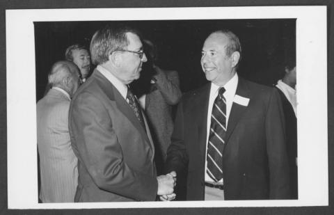 Portrait of Former Nevada Governor Grant Sawyer (left) greets Clifford Perlman (right).