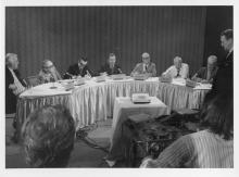 Dick Hannah (standing at far right) at the 1972 telephone press conference with Hughes, who was in the Bahamas. The press conference was a media event designed to dispel rumors of Hughes death, the collapse of his Nevada Empire, and the Clifford Irving-Hughes Autobiography hoax.