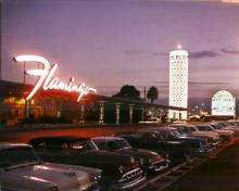 In 1953 the Flamingo was remodeled with a new facade and the famous champagne tower sign. Hughes was living in the Flamingo in 1953.