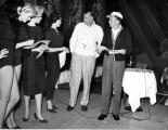 Photograph of the Copa Girls rehearsing with Jack Entratter and Frank Sinatra, Las Vegas, 1954