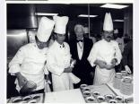 Nat Hart in the kitchen at the Desert Inn with chefs, circa 1990