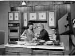 Muriel Stevens cooking with a guest on her tv show, circa 1975