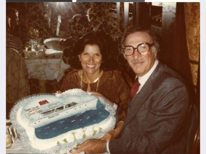 Joyce and Jerry Mack with cruise ship cake celebrating their anniversary, March 30, 1979