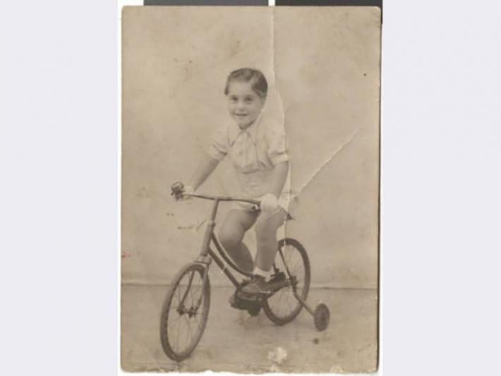 Photograph of Maurice Behar a bicycle, August 24, 1942