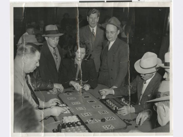 Photograph of people playing Faro game at Golden Nugget, 1930s