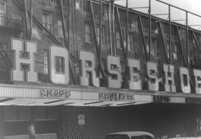 Sign and construction on the exterior of the Horseshoe Club